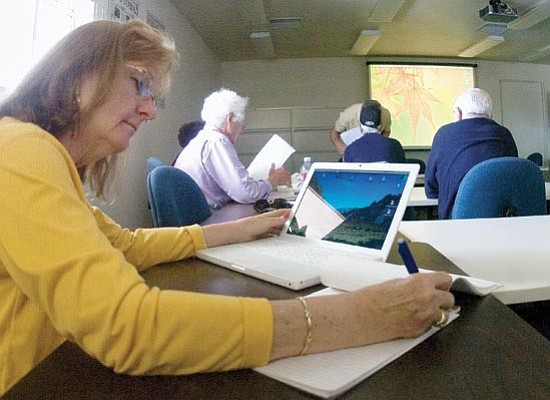 Matt Hinshaw/The Daily Courier<p> Linda Wyatt takes notes during a Macintosh class led by Paul Mauro Wednesday afternoon at the Osher Lifelong Learning Institute at Yavapai College in Prescott.