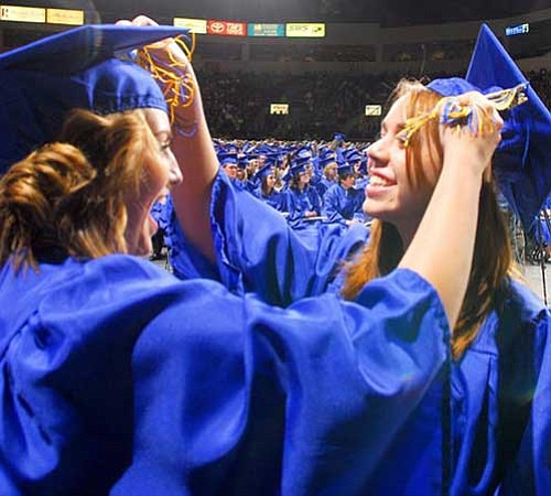 Matt Hinshaw/The Daily Courier<br> Smiles were what the Prescott High School Class of 2008 wore most at Tim's Toyota Center.