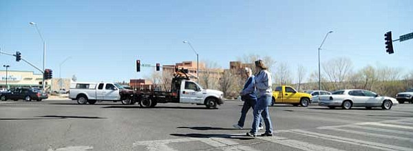 Les Stukenberg/The Daily Courier<br> Shannon and Reno cross the intersection called Four Points in Prescott on Friday morning. Shannon said the right-turn lane from Iron Springs onto Miller Valley Road is very dangerous for her crossing.