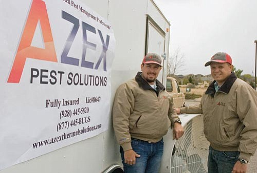 Matt Hinshaw/The Daily Courier<p> Ron Ketner and Grant Fernow, co-owners of AZEX Pest Control, stand next to their equipment trailer in Prescott Wednesday afternoon.