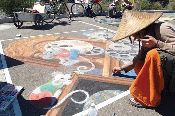 Lorin McLain/The Daily Courier<br> Margaret Dewar works on an Earth Day inspired piece at the Chalk It Up! Festival Sunday afternoon.