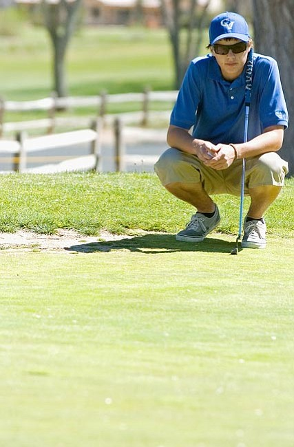 Matt Hinshaw/The Daily Courier Chino Valley's Justin Ludwig surveys the green Monday at Antelope Hills Golf Course. Ludwig and Chino played a home match for the first time this season.