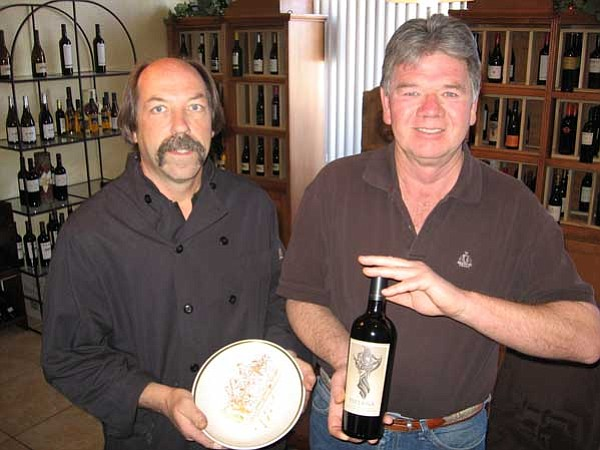 Jason Soifer/The Daily Courier<br> Darryl Tingler, left, owner of Saffron Bistro, stands with Mike Arntzen, owner of Lonesome Valley Wine Co., which operates a wine bar in Saffron.