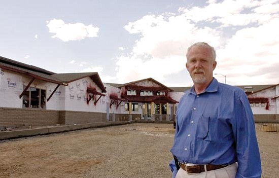 Matt Hinshaw/The Daily Courier<p> Architect Chris Browning stands in front of the new Department of Economic Security building in Prescott Valley Wednesday afternoon. The new DES building is reportedly ahead of schedule and under budget.
