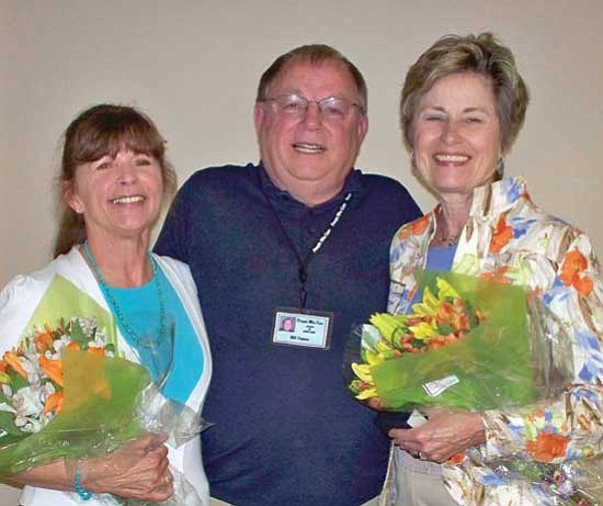 Courtesy<p> People Who Care president of the board Bill Towne congratulates Harriet Burger, above left, and Jean Anne Morrow, right, on receiving the Outstanding Contribution Award.