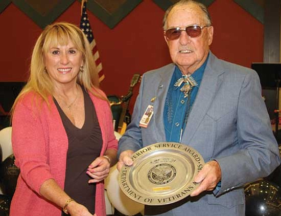 Courtesy photo<br> Susan A. Angell, left, director of the Northern Arizona Veterans Affairs Health Care System, congratulates John Been on being its top volunteer award recipient.