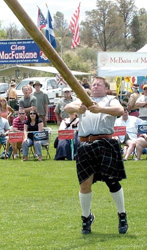 The Daily Courier/file<p> Kevin Robinson of Phoenix participates in a Caber toss.
