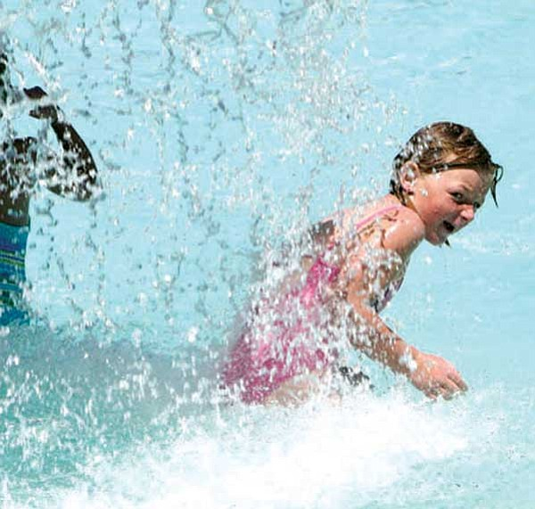 Chino Valley Review/Courtesy photo<br> Chloe Jones gets splashed at the town's pool.