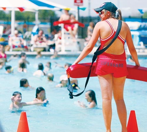 The Daily Courier/Les Stukenberg<p> Blair Gledhil and other lifeguards keep a close watch on the young and old swimmers in the pool at Mountain Valley Park in Prescott Valley June 17, 2008.