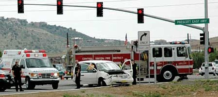 Photo by Sue Tone<br>Prescott Valley police direct traffic at Highway 69 and Prescott East Highway.
