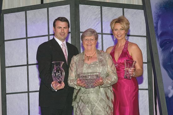 Courtesy photo<p> Susan Abbott, center, is flanked by Paul and Lori Hogan, founders of Home Instead Senior Care.
