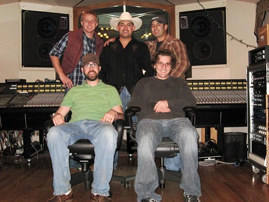 Courtesy photo<p> Albert Lopez (top right) stands with his brother, Allan Lopez (top center) with Plaid Star Records producers.