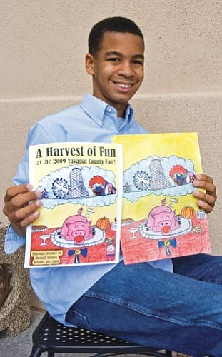 Matt Hinshaw/The Daily Courier<br> Jordan Shipp, 12, a student at Granite Mountain Middle School, displays the winning design he submitted in the contest for the Yavapai County Fair Premium Book.