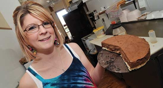 Les Stukenberg/<br>The Daily Courier<br>Shannon Russo, owner of Shannon's Gourmet Cheesecakes in Prescott, holds up a chocolate mocha cheesecake, one of the most popular of the many cheescakes that she sells either by the slice or as a whole cake.