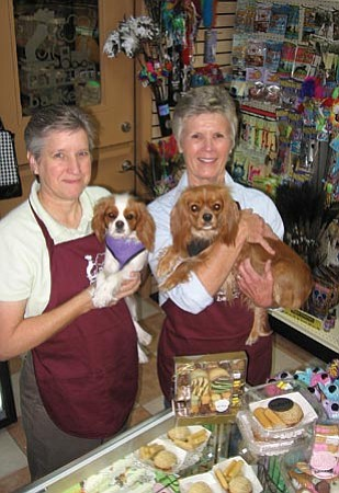 Jason Soifer/The Daily Courier<p> Donna Holick, left, and Charlotte Peters, owners of Pet Depot Barkery in Prescott, hold their store mascots and greeters Pearl and Ruby, Cavalier King Charles spaniels.