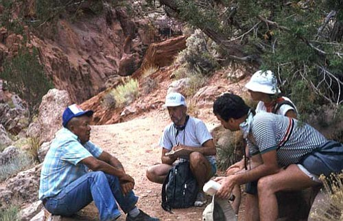 Courtesy photo<br> A Navajo guide talks with Edventure participants in Canyon de Chelly.