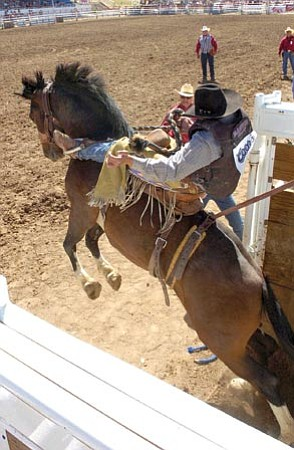 The Daily Courier/file<p> A rider surges forward at the 2007 rodeo.