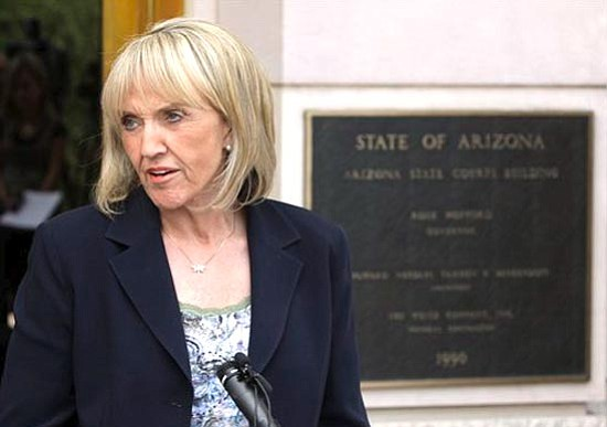 Ross D. Franklin/The Associated Press<p> Arizona Republican Gov. Jan Brewer holds a news conference in front of the Arizona State Courts Building in Phoenix June 16.