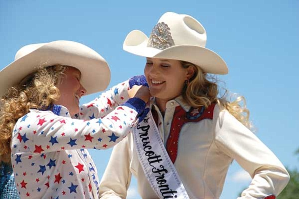 Bruce Colbert/The Daily Courier<br> Outgoing Prescott Frontier Days Queen Jordan Anderson, left, crowns Chantel Miles, 19, as the 2010 Queen Sunday at the Rodeo Grounds during the final day of Prescott Frontier Days.