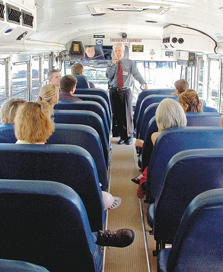 Paula Rhoden/<br>The Daily Courier<br>Prescott Unified School District Superintendent Kevin Kapp leads new teachers on a bus tour of the district. Kapp told the new teachers a short history of each of the schools in the district. Students start school Monday.