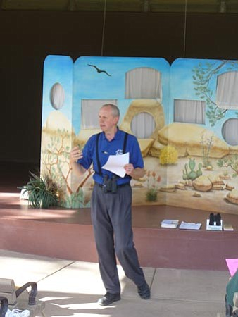 Courtesy photo<br> Eric Moore talks to an audience about birds.