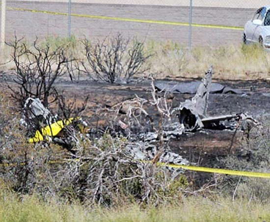 Les Stukenberg/The Daily Courier<p> The remains of the single-engine airplane await investigators Monday.