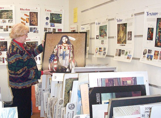 Sue Tone/Courtesy photo<p> Prescott Art Docent Iyone Meyer pulls out one of 600 mounted posters in the PAD office. The docents can draw upon the art posters, 1,000 art books and digital presentations when making their presentations to schools and groups.