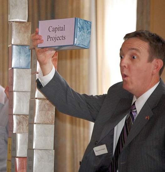 Joanna Dodder/The Daily Courier<p><br/>Arizona Secretary of State Ken Bennett uses tissue boxes during a presentation in Prescott Tuesday to illustrate components of the state budget.<br/><br/>