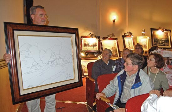 Bruce Colbert/The Daily Courier<p> Then-gallery manager Ernie Migliorini shows off Thomas Kinkade's original sketch in this file photo from March.