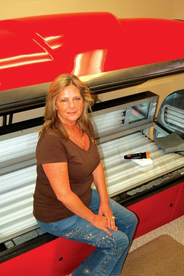 Jason Soifer/The Daily Courier<p> Beth Ashe owns Brown Buns Tanning in Prescott Valley. Ashe opened the business in 2004.