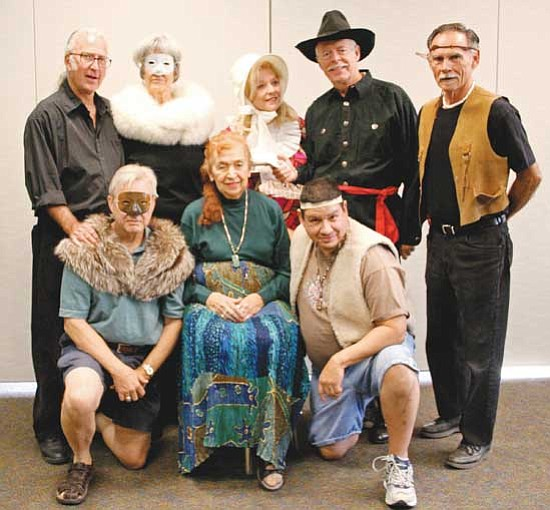 Karen Despain/<br>The Daily Courier<br>Playwright and director Robert Wiltsey, back row left, stands with characters in Custer and Friends, back row, from left, Elaine Jordan, Grace Lemmon, Chuck Post and Robert Dittberner, and front row, from left, Bill Haas, Bunny Sherman and Alex Gabaldon, during a rehearsal for the play, which will be Sunday at the Prescott Public Library.