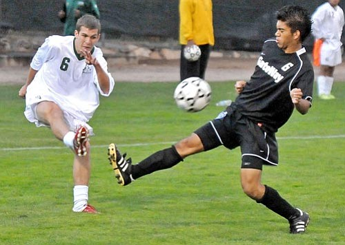Ryan Fuertsch, left, seen here in action versus Gateway CC on Wednesday, and the rest of the Yavapai College soccer team dropped to No. 12 in the latest NCJAA Division-I poll  Matt Hinshaw/The Daily Courier