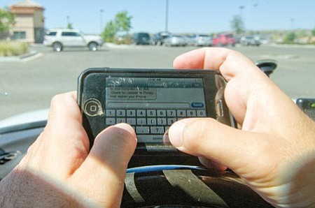 Les Stukenberg, photo illustration/The Daily Courier<br> AAA of Arizona supports a ban on texting while driving in Arizona.