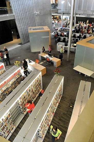 Matt Hinshaw/<br>The Daily Courier<br>Patrons strolled through the main room of the new Prescott Valley Public Library Saturday morning after its dedication.