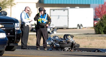 Les Stukenberg/The Daily Courier<p> Prescott Valley Police officials investigate the scene of a two-vehicle collision involving this motorcycle that closed eastbound Highway 69 Thursday afternoon from Prescott East Highway to Glassford Hill Road.