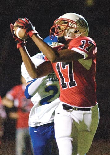 The Orme School's Theo Turner hauls in a pass versus visiting Gila Bend on Friday. Turner had two touchdown catches in the state tourney win.  Les Stukenberg/The Daily Courier