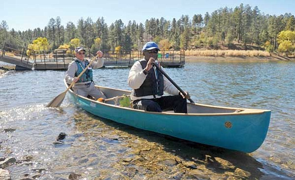 Matt Hinshaw/The Daily Courier<br> Al Lewis, right, and Ron Russell, a volunteer with the Prescott Paddle Club, push away from shore Wednesday afternoon during the Yavapai College EdVentures at Lynx Lake in Prescott. The program is for vision and hearing impaired residents.
