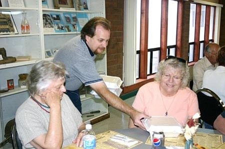 """Salina Sialega/Special to the Courier<br> Volunteer Tom Payne serves lunches Friday at the Chino Valley Senior Center to Lynette Bjornstad, right, and Adawna Saapo, during a """"soft opening"""" practice run of the Friday lunches that will begin Nov. 13."""