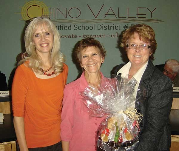 Steven T. Owings/Courtesy photo<p> Carolyn Reeder, left, Territorial Elementary School principal, and Penny Hubble, right, of State Farm Insurance, sponsor of the Teacher of the Quarter Award, congratulate Vikki McCloud, Teacher of the Quarter for Chino Valley Unified School District.
