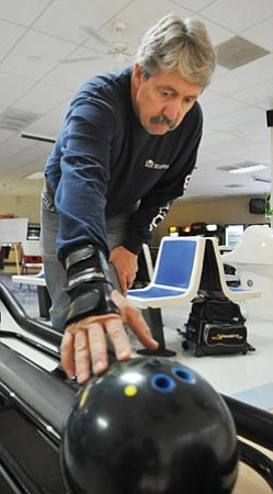 Les Stukenberg/The Daily Courier<br> One activity that Phil Phillips enjoys is bowling since getting treatment in Germany for his Parkinson's disease.