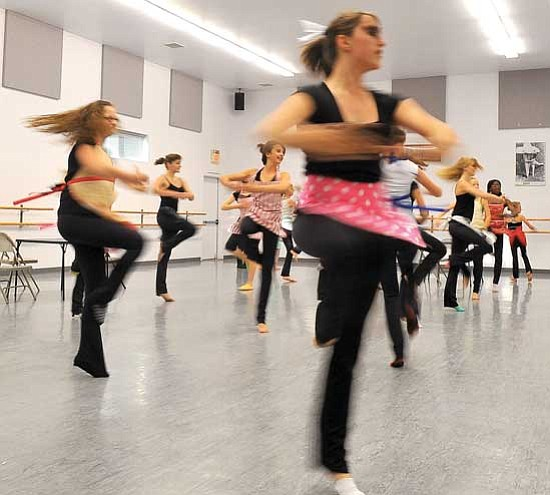 "Matt Hinshaw/<br>The Daily Courier<br>Emily Thompson, 13, and her fellow dancers rehearse Wednesday afternoon for The Dance Studio's upcoming Christmas performance, ""Rockin' in the Pines."" About 150 dancers perform a variety of traditional and modern dance routines."