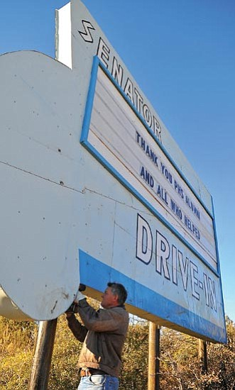 Matt Hinshaw/<br>The Daily Courier<br>Volunteer Don Willis helps resurrect the Senator Drive-In sign Friday morning in Prescott. The sign was originally taken down on Oct. 15, 2008.