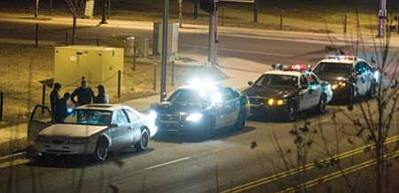 Les Stukenberg/The Daily Courier<br> Prescott Valley police stop and question a suspect for driving under the influence early Saturday evening on Florentine Road between Glassford Hill and Lake Valley roads. The suspect was taken into custody and the vehicle towed.