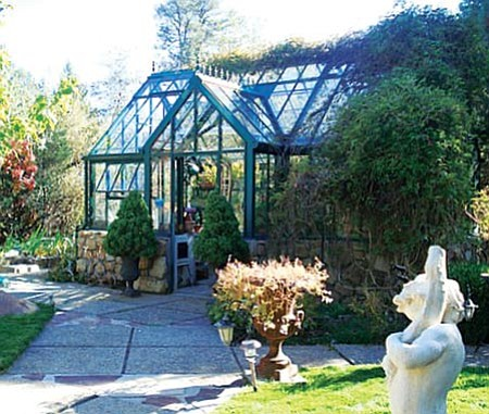 Courtesy/Joan Dukes This glass Victorian greenhouse in Prescott keeps flowers inside for the winter.