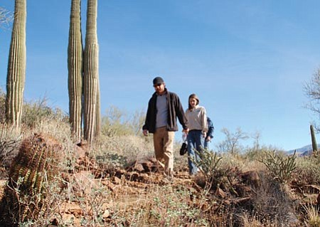 Bruce Colbert/The Daily Courier<p> Pat Kelly, left, and Allison Laramee, professional trail builders with the Coconino Rural Environment Corps, take a hike on the Black Canyon Trail Jan. 8 at Black Canyon City.