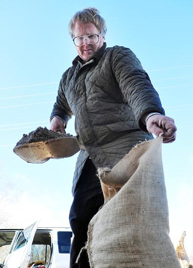 Les Stukenberg/The Daily Courier<p> Dean Taylor, who lives near Granite Creek in Prescott, fills sandbags at Prescott Fire Department station 71 to help protect his trailer from the potential flooding that may occur if Prescott gets the amount of rain that forecasters are predicting over the next few days.