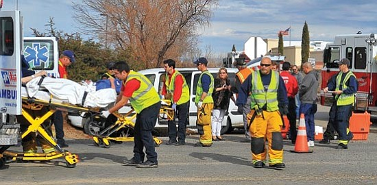 Matt Hinshaw/The Daily Courier<p> Emergency personnel carry two victims involved in a two-vehicle accident at the intersection of Frontage Road and Valley View Road into two waiting LifeLine Ambulances Wednesday morning in Prescott Valley. Both victims were transported to Yavapai Regional Medical Center East with major injuries.