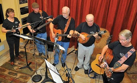 Matt Hinshaw/The Daily Courier Members of the Cool Water Band practice at a home in Prescott Tuesday afternoon. The Cool Water Band will be playing at Barnes and Noble bookstore at the Prescott Gateway Mall 3 p.m. Saturday.