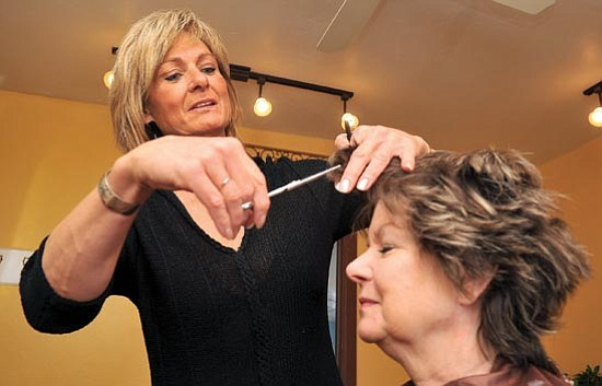 Matt Hinshaw/<br>The Daily Courier<br>Saylor Russell prepares Shari Stanalonis hair for a foil weave Tuesday morning in Prescott. Russell opened Saylor's Salon in December of 2009 and she has been a stylist for the past 25 years.