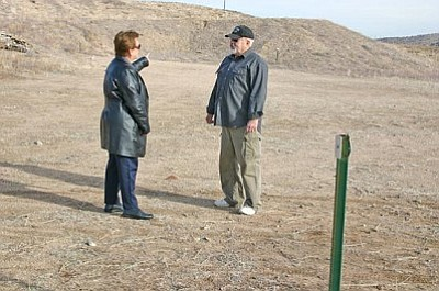 Salina Sialega/<br>Special to the Courier<br>Chino Valley Police Chief Pat Huntsman talks with Chino Valley Council Member Joel Baker Wednesday at the town's current shooting range off Perkinsville Road. The council is considering suggested changes to the range.